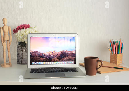 KYIV, UKRAINE - OCTOBER 18, 2017: Apple MacBook Air Silver with desktop screensaver on table indoors - Stock Photo