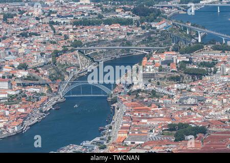 Aerial view of Porto and Vila Nova de Gaia including the famous Dom Luis I Bridge and Douro River. The bridge was designed by Théophile Seyrig who was - Stock Photo