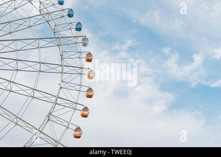 Half of the Ferris wheel against sky. - Stock Photo