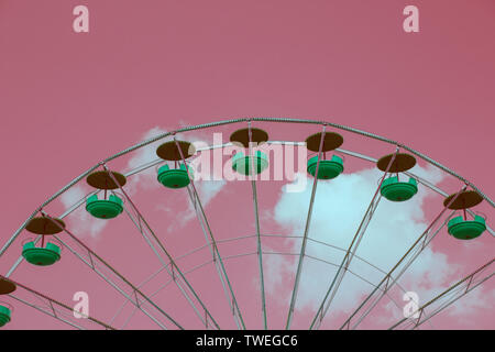 Bright pink toned picture of a Ferris wheel - Stock Photo