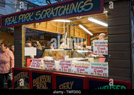 Trader selling pork products at St Nicholas Fayre. - Stock Photo
