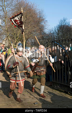 Procession of people in costume at the Viking Festival. - Stock Photo