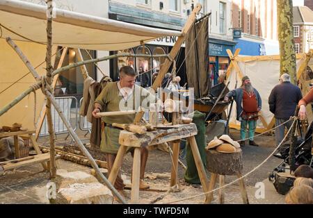 Man demonstrating wood turning at the Viking Festival. - Stock Photo