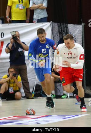KYIV, UKRAINE - JUNE 12, 2019: Lasse Bredekjaer ANDERSSON of Denmark (R) fights for a ball with Oleksandr TILTE of Ukraine during their EHF EURO 2020 - Stock Photo