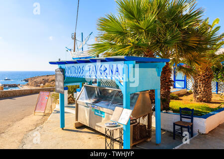 FINIKI PORT, KARPATHOS ISLAND - SEP 25, 2018: Stand presenting fresh fish to eat in taverna restaurant in village on coast of Karpathos island, Greece - Stock Photo