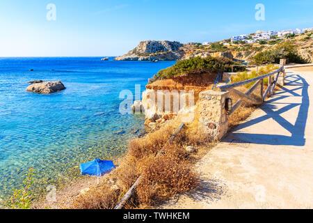 Coastal walkway along beautiful sea at Ammopi beach, Karpathos island, Greece - Stock Photo