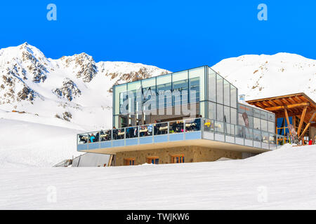 SERFAUS FISS LADIS SKI AREA, AUSTRIA - FEB 14, 2019: Sun terrace of modern glass restaurant on ski slope in Austrian Alps mountains in beautiful winte - Stock Photo