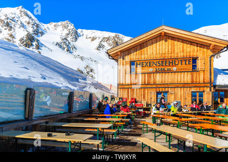 SERFAUS FISS LADIS SKI AREA, AUSTRIA - FEB 14, 2019: Terrace of wooden mountain hut restaurant on ski slope in Austrian Alps in beautiful winter snow, - Stock Photo