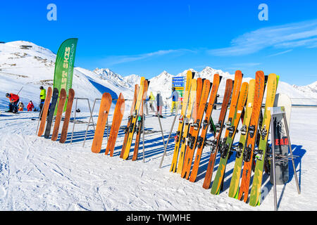 SERFAUS FISS LADIS SKI AREA, AUSTRIA - FEB 14, 2019: Classic vintage wooden skis on display on slope in Austrian Alps mountains in beautiful winter sn - Stock Photo