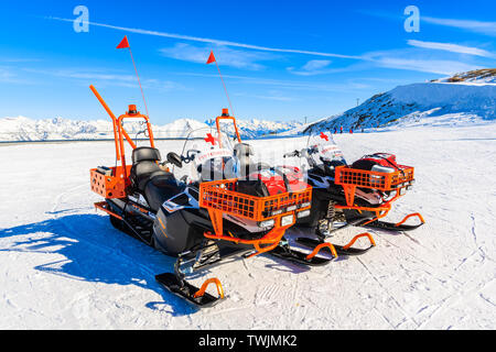 SERFAUS FISS LADIS SKI AREA, AUSTRIA - FEB 14, 2019: Rescue service snowmobiles parking on ski slope in Serfaus Fiss Ladis winter resort, Tirol. Austr - Stock Photo