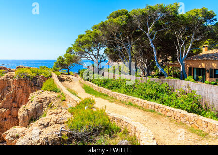 Trekking path along seacoast from Cala Aigua to Cala Marquesa, Costa Brava, Spain - Stock Photo