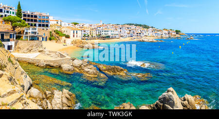 Panorama of amazing beach in Calella de Palafrugell, scenic fishing village with white houses and sandy beach with clear blue water, Costa Brava, Cata - Stock Photo