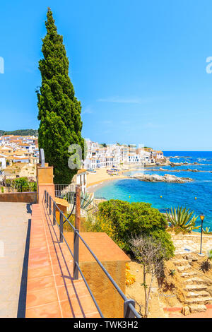 Amazing view of Calella de Palafrugell, scenic fishing village with white houses and sandy beach with clear blue water, Costa Brava, Catalonia, Spain - Stock Photo