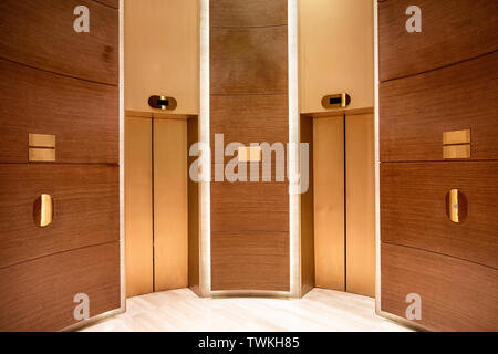 Closed elevator doors. Contemporary interior wooden curved - Stock Photo