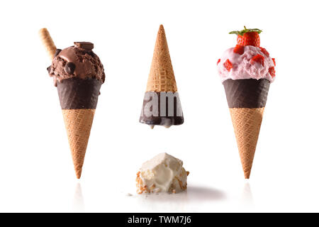 Concept summer funny ice cream. With upside down and ice cream and crushed ice cream ball on the white table. Decorated with fruit and processing prod - Stock Photo