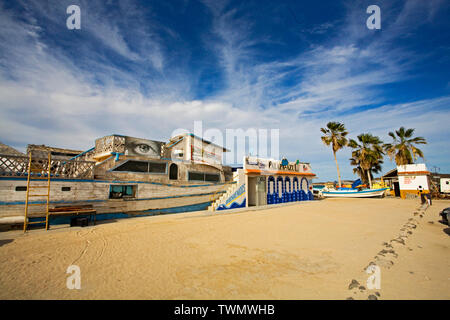 A fishing boat combined with a house to make a bar and grill at Tecolote Beach, east of La Paz, Baja, Mexico, the capital of Baja. - Stock Photo