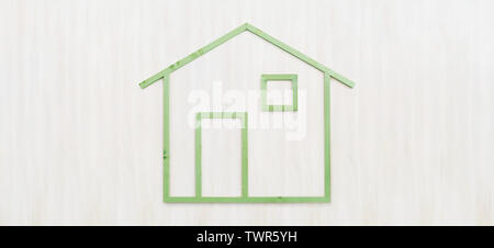 wood green house shape isolated on wooden white background, green building ecology house concept - Stock Photo
