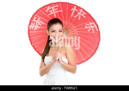 Chinese new year woman with traditional umbrella with HAPPY CHINESE NEW YEAR written in Chinese. Beautiful mixed race Chinese Asian / Caucasian girl isolated on white background smiling pretty. - Stock Photo