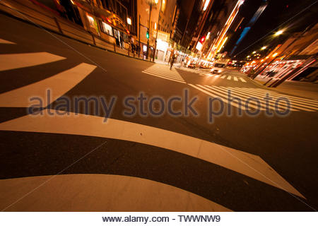 Tokyo, Japan - November 25, 2012 : Senso ji is one of the most visited religious sights but in the evening Asakusa is deserted and big traffic crossin - Stock Photo