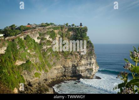 Panoramic view of Pura Luhur Uluwatu temple in a cliff, Bali, Indonesia. - Stock Photo