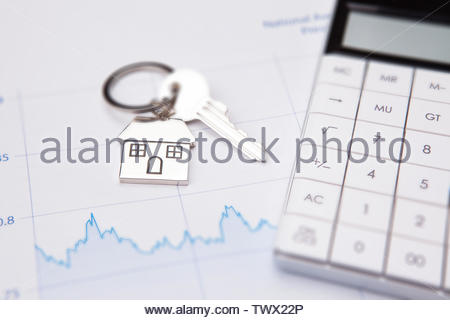An empty mortgage application form with house key - Stock Photo