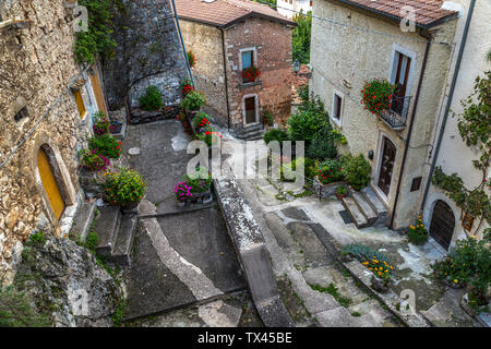Downhill alley of a mountain village - Stock Photo
