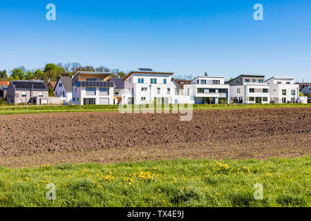 Germany, Magstadt, modern one-family houses with solar thermal energy - Stock Photo