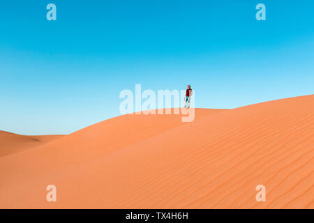 Senior man standing on dune, looking at view, Wahiba Sands, Oman - Stock Photo