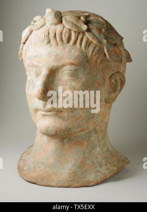 'Head of a Man Wearing a Laurel-Wreath; English:  Italy, Etruscan, 2nd century B.C. Sculpture Terracotta Height: 11 1/2 in. (29.21 cm) Gift of Robert Blaugrund (M.82.77.13) Greek, Roman and Etruscan Art; 2nd century BC date QS:P571,-150-00-00T00:00:00Z/7; ' - Stock Photo