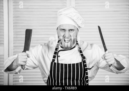Chef choose professional tools. Chef hold cleaver knife tool ready to chop ingredients. Man wear apron cooking in kitchen. Man use sharp cleaver knife. Types of knives. Sharp knife professional tool. - Stock Photo