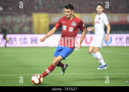 English-born Taiwanese football player Tim Chow of Henan Jianye dribbles against Shenzhen F.C. in their 14th round match during the 2019 Chinese Football Association Super League (CSL) in Zhengzhou city, central China's Henan province, 22 June 2019. Henan Jianye defeated Shenzhen F.C. 1-0. - Stock Photo