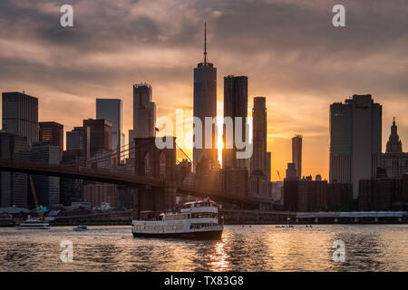 Sunset over the Brooklyn Bridge and East River, New York, USA - Stock Photo