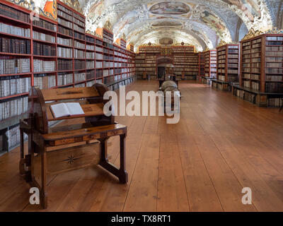 Prague, Czech Republic - June 8 2019: Interior of the Strahov Monastery Library, the Theological Hall. A Famous Baroque Library in Bohemia. - Stock Photo