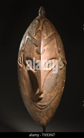 'Mask; English:  Papua New Guinea, East Sepik Province, Lower Sepik River, Coastal Zone, circa 1909 Jewelry and Adornments; masks Wood and traces of pigment 15 1/2 x 6 1/4 x 4 in. (39.37 x 15.88 x 10.16 cm) Purchased with funds provided by the Eli and Edythe Broad Foundation with additional funding by Jane and Terry Semel, the David Bohnett Foundation, Camilla Chandler Frost, Gayle and Edward P. Roski and The Ahmanson Foundation (M.2008.66.28) Art of the Pacific Currently on public view: Ahmanson Building, floor 1; circa 1909 date QS:P571,+1909-00-00T00:00:00Z/9,P1480,Q5727902; ' - Stock Photo