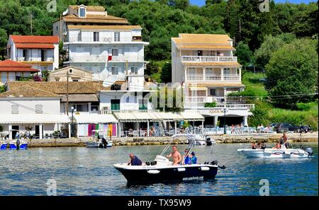Tourists arriving at Kassiopi bay in a hire boat,Kassopaia,Ionian Islands, Corfu ,Greece - Stock Photo