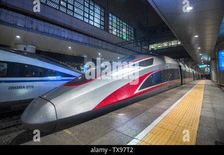 The Fuxing CR400AF high-speed EMU train, independently designed and developed by China China Automobile Group's Quartet Locomotive Vehicle Co., Ltd. is docked at Beijing West Station. - Stock Photo