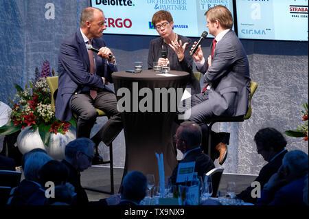 24 June 2019, North Rhine-Westphalia, Duesseldorf: CDU politician Friedrich Merz (l), CDU chairman Annegret Kramp-Karrrenbauer (M), and Michael Bröcker, editor-in-chief of the Rheinische Post (r), sit on stage at the Ständehausreff of the 'Rheinische Post'. Photo: Henning Kaiser/dpa - Stock Photo