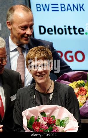 24 June 2019, North Rhine-Westphalia, Duesseldorf: CDU chairman Annegret Kramp-Karrrenbauer (v) and CDU politician Friedrich Merz will be on stage at the Ständehausreff of the 'Rheinische Post'. Photo: Henning Kaiser/dpa - Stock Photo