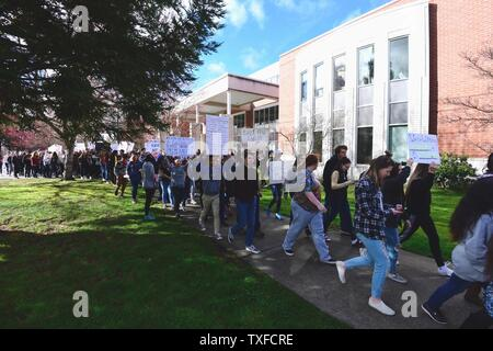 Grants Pass High School students participate a national walkout to honor Florida school shooting victims, in Grants Pass, Oregon, March 14, 2018. The youth-organized protest brought attention to school safety, protested gun violence, and honored the 17 victims of the shooting at Marjory Stoneman Douglas High School. Photo by David Tulis/UPI - Stock Photo