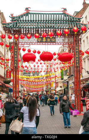 LONDON, UK - JANUARY 24, 2011: Gerrard Street in London's China town decorated with chinese lanterns for celebrate of the Chinese New Year - Stock Photo