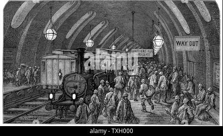 'The Workmen's Train'. From Gustave Dore and Blanchard Jerrold 'London: A Pilgrimage' London 1872. This picture shows steam trains at Gower Street station on the Metropolitan (underground) railway which opened in 1863. Workers hurry to catch their morning train. Wood engraving - Stock Photo