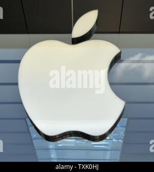 The Apple logo is displayed prominently at the Apple store on September 9, 2014 in Chicago. Apple announced new products Tuesday including the iPhone 6, Apple Pay and the Apple Watch during a press event at their headquarters in Cupertino, California.     UPI/Brian Kersey - Stock Photo