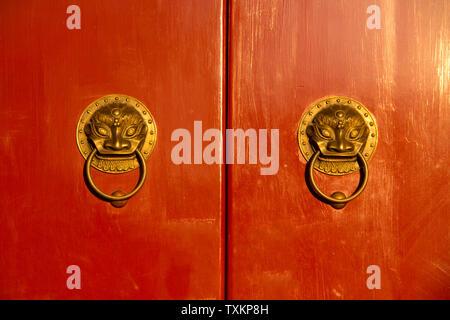 Red gate, golden door buckle. - Stock Photo