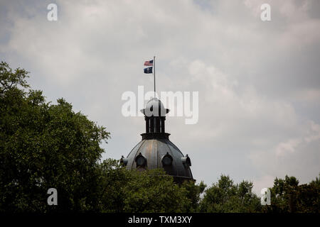 The top of the State House in Columbia, South Carolina is seen on July 9, 2015. The South Carolina Legislature has passed a bill to remove the Confederate flag from the State House grounds. The governor will sign at 4 p.m. today. This comes in the wake of the nine people killed at Emanuel African Methodist Episcopal Church in Charleston, South Carolina on July 17, 2015.  A suspect, Dylann Roof, 21, has been indicted for the shootings.  Photo by Kevin Liles/UPI - Stock Photo