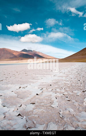 Tuyajto lagoon and salt lake in the Altiplano over 4000 meters over the sea level with salt crust in the shore, Los Flamencos National Reserve, Atacam - Stock Photo
