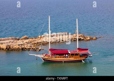 "Pleasure day tripper boat ""luna"" entering Kyrenia harbour, Girne, Turkish Republic of Northern Cyprus. - Stock Photo"