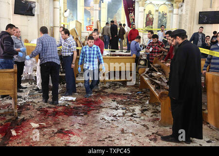 Security personnel and people look at the aftermath following a bomb blast which struck worshipers gathering to celebrate Palm Sunday at the Mar Girgis Coptic Church in the Nile Delta City of Tanta, north of Cairo, on April 9, 2017. At least 40 were killed and dozens injured  in Explosions in churches in Tanta and Alexandria in Egypt.      Photo by Karem Ahmed/ UPI - Stock Photo