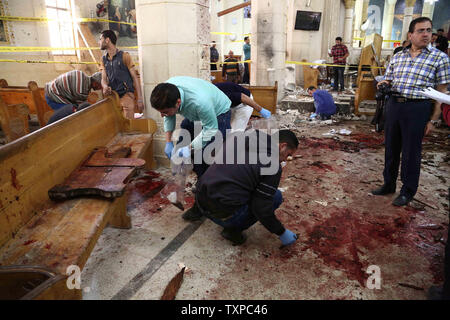 Security personnel and people looking at the aftermath following a bomb blast which struck worshippers gathering to celebrate Palm Sunday at the Mar Girgis Coptic Church in the Nile Delta City of Tanta,  northen of Cairo, on April 9, 2017. At least 40 Were Killed and dozens were injured  in an Explosions in  Churchs in Tanta and Alexandria in Egypt. photo by Karem Ahmed/ UPI - Stock Photo