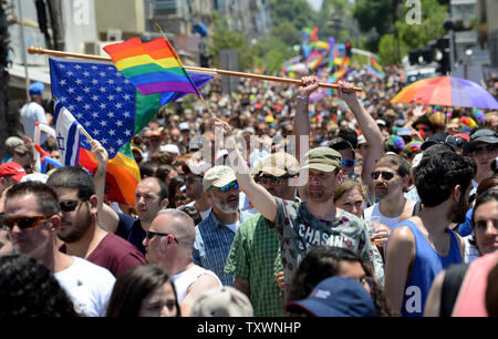 A gay man waves a rainbow flag in the 17th annual Gay Pride Parade in Tel Aviv, Israel, June 12, 2015. More than 180,000 marched in the parade, including 30,000 tourists. The theme of the parade was 'Tel Aviv Loves All Genders' in an effort to promote equal rights to members of the transgender community.  Photo by Debbie Hill/UPI - Stock Photo