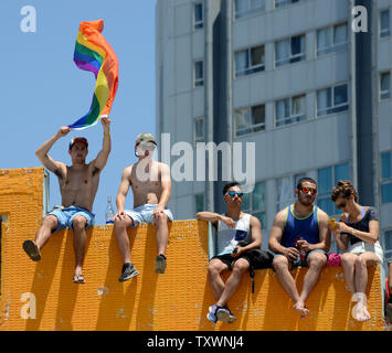 A man waves a rainbow flag during the 17th annual Gay Pride Parade in Tel Aviv, Israel, June 12, 2015. More than 180,000 marched in the parade, including 30,000 tourists. The theme of the parade was 'Tel Aviv Loves All Genders' in an effort to promote equal rights to members of the transgender community.  Photo by Debbie Hill/UPI - Stock Photo
